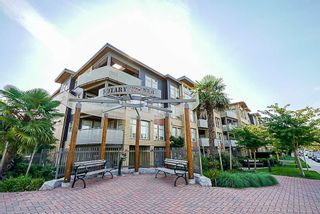 "Photo 1: 205 1166 54A Street in Tsawwassen: Tsawwassen Central Condo for sale in ""Brio"" : MLS®# R2302910"