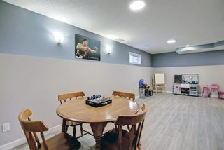 Photo 36: 56 Woodside Road NW: Airdrie Detached for sale : MLS®# A1144162