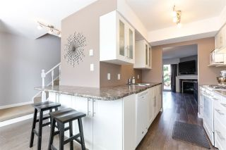 """Photo 1: 43 4947 57 Street in Delta: Hawthorne Townhouse for sale in """"OASIS"""" (Ladner)  : MLS®# R2361943"""