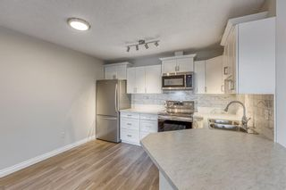 Photo 2: 311 10 Sierra Morena Mews SW in Calgary: Signal Hill Apartment for sale : MLS®# A1093086