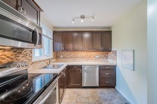 Photo 6: 117 Storybook Terrace NW in Calgary: Ranchlands Row/Townhouse for sale : MLS®# A1127202