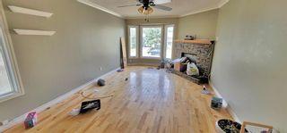 Photo 5: 11228 Braeside Drive SW in Calgary: Braeside Detached for sale : MLS®# A1148483