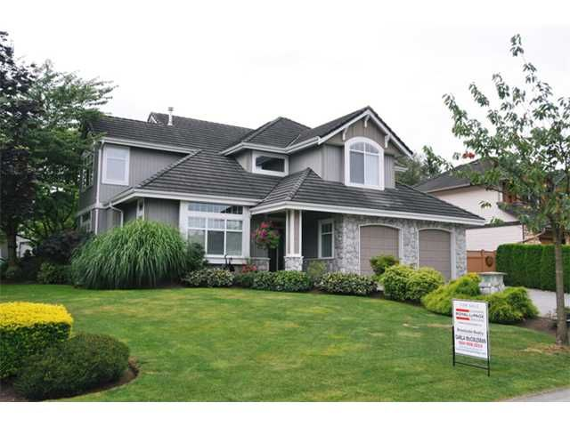 West Maple Ridge home on corner/cul-de-sac lot in The Heath.  This 9 year old home oozes with quality craftsmanship, with hidden and recessed lighting, crown molding, and coffered ceilings throughout.