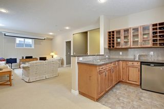Photo 33: 145 TREMBLANT Place SW in Calgary: Springbank Hill Detached for sale : MLS®# A1024099