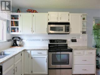 Photo 8: 909 10A Avenue SE in Slave Lake: House for sale : MLS®# A1128876