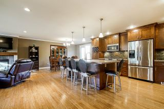 Main Photo: 8546 144A Street in Surrey: Bear Creek Green Timbers House for sale : MLS®# R2625770