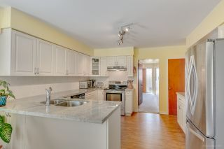 Photo 8: 7796 ROSEWOOD Street in Burnaby: Burnaby Lake House for sale (Burnaby South)  : MLS®# R2163744