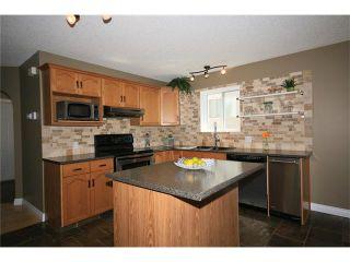 Photo 10: 5 WEST TERRACE Crescent: Cochrane House for sale : MLS®# C4048617