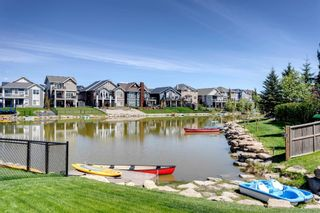 Photo 4: 329 Bayside Crescent SW: Airdrie Detached for sale : MLS®# A1129242