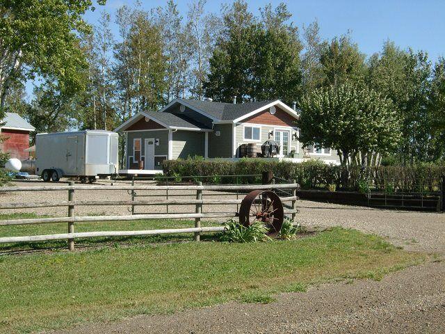 Main Photo: 1016 240 Road in Fort St. John: Fort St. John - Rural E 100th House for sale (Fort St. John (Zone 60))  : MLS®# R2556289