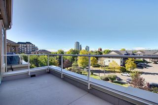 Photo 2: 6401 14 HEMLOCK Crescent SW in Calgary: Spruce Cliff Apartment for sale : MLS®# A1036904