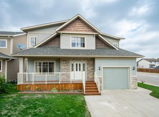 Photo 2: 2 Mackenzie Way: Carstairs Detached for sale : MLS®# A1132226