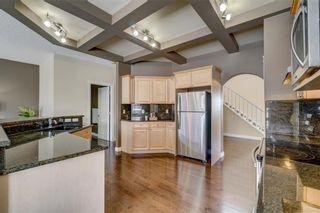 Photo 21: 204 SUNTERRA Boulevard: Cochrane House for sale : MLS®# C4164735