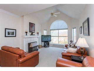 "Photo 1: 410 12464 191B Street in Pitt Meadows: Mid Meadows Condo for sale in ""LASEUR MANOR"" : MLS®# R2449917"