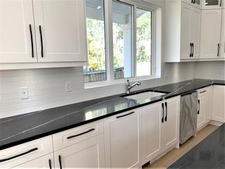 Photo 12: 11 Rockford Park NW in Calgary: Rocky Ridge Detached for sale : MLS®# A1154593