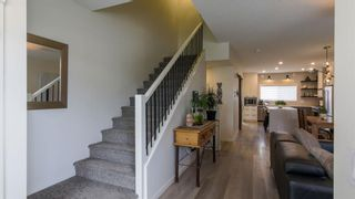 Photo 2: 46 Wolf Creek Manor SE in Calgary: C-281 Detached for sale : MLS®# A1145612