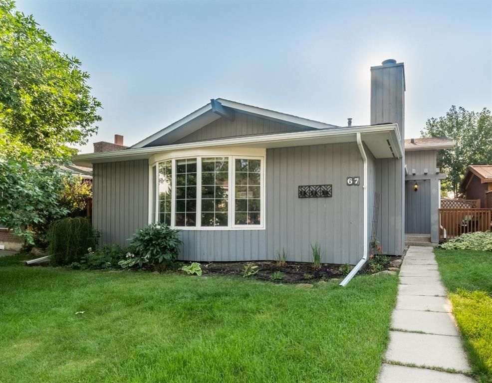 Charming home on quiet street, one block from the lake.