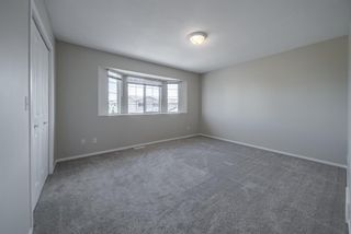 Photo 30: 404 720 Willowbrook Road NW: Airdrie Row/Townhouse for sale : MLS®# A1098346