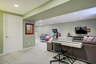 Photo 20: 33 Wakefield Drive SW in Calgary: Westgate Detached for sale : MLS®# A1070193