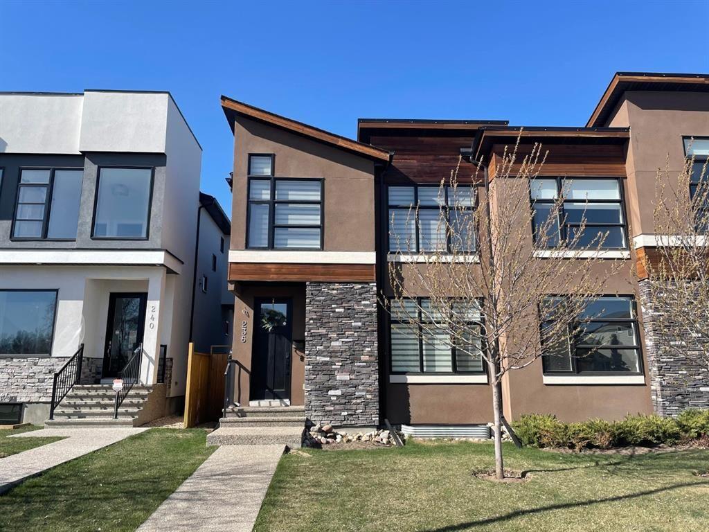 Main Photo: 236 25 Avenue NW in Calgary: Tuxedo Park Semi Detached for sale : MLS®# A1101749