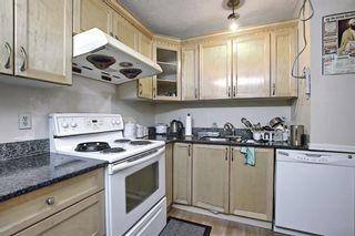 Photo 10: 34 Falconridge Close NE in Calgary: Falconridge Semi Detached for sale : MLS®# A1126419