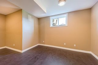 Photo 18: 415 52 Avenue SW in Calgary: Windsor Park Semi Detached for sale : MLS®# A1112515