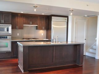 "Photo 2: 105 3595 W 18TH Avenue in Vancouver: Dunbar Townhouse for sale in ""DUKE ON DUNBAR"" (Vancouver West)  : MLS®# V1050482"