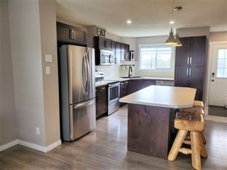 Photo 8: 1404 Clover Link: Carstairs Row/Townhouse for sale : MLS®# A1073804