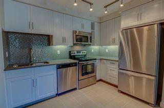 Photo 5: 106 25 Auburn Meadows Avenue SE in Calgary: Auburn Bay Apartment for sale : MLS®# A1124019