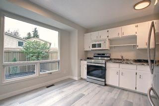 Photo 8: 77 123 Queensland Drive SE in Calgary: Queensland Row/Townhouse for sale : MLS®# A1145434