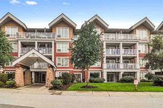 "Photo 1: 105 6450 194 Street in Surrey: Clayton Condo for sale in ""Waterstone"" (Cloverdale)  : MLS®# R2508287"