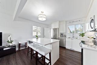 Photo 8: 805 67 Avenue SW in Calgary: Kingsland Detached for sale : MLS®# A1115484