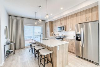 Photo 8: 146 Shawnee Common SW in Calgary: Shawnee Slopes Row/Townhouse for sale : MLS®# A1099355