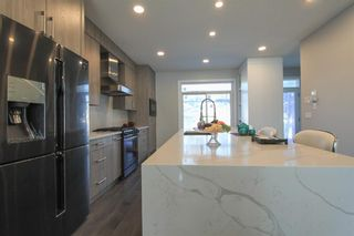 Photo 5: 2410 54 Avenue SW in Calgary: North Glenmore Park Semi Detached for sale : MLS®# A1082680