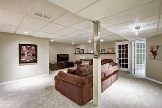 Photo 27: 607 Stratton Terrace SW in Calgary: Strathcona Park Row/Townhouse for sale : MLS®# A1065439