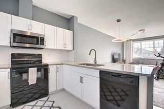 Photo 20: 504 281 Cougar Ridge Drive SW in Calgary: Cougar Ridge Row/Townhouse for sale : MLS®# A1123514