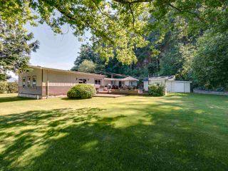 Main Photo: 35008 TOWNSHIPLINE Road in Abbotsford: Matsqui House for sale : MLS®# R2589478