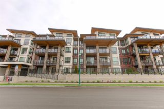 """Photo 1: 402 12460 191 Street in Pitt Meadows: Mid Meadows Condo for sale in """"ORION"""" : MLS®# R2436076"""