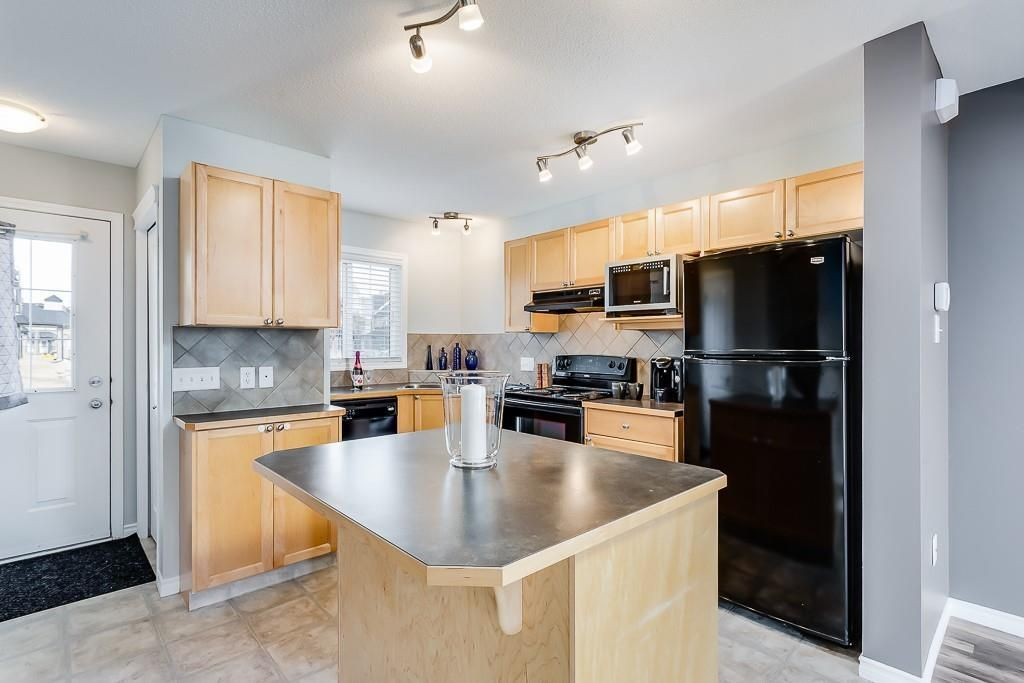 Main Photo: 1401 140 SAGEWOOD Boulevard SW: Airdrie Row/Townhouse for sale : MLS®# A1151649