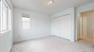 Photo 23: 48 Moreuil Court SW in Calgary: Garrison Woods Detached for sale : MLS®# A1075333