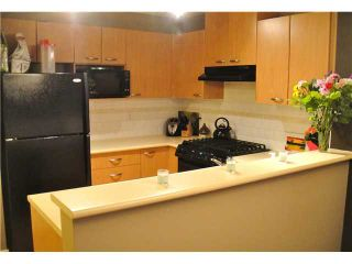 """Photo 3: 408 2966 SILVER SPRINGS Boulevard in Coquitlam: Westwood Plateau Condo for sale in """"TAMARISK"""" : MLS®# V933089"""
