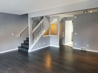 Photo 5: 7 Patina Point SW in Calgary: Patterson Row/Townhouse for sale : MLS®# A1085180