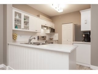 "Photo 6: #402 13860 70 Avenue in Surrey: East Newton Condo for sale in ""Chelsea Gardens"" : MLS®# R2435738"