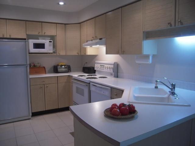 """Main Photo: 1541 BOWSER Avenue in North Vancouver: Norgate Townhouse for sale in """"Illahee"""" : MLS®# V853423"""