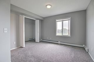 Photo 29: 6413 304 Mackenzie Way SW: Airdrie Apartment for sale : MLS®# A1128019