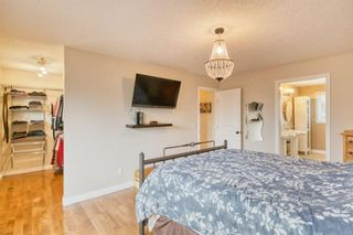 Photo 11: 131 Queensland Circle SE in Calgary: Queensland Detached for sale : MLS®# A1148253