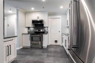 "Photo 14: 207 33688 KING Road in Abbotsford: Poplar Condo for sale in ""COLLEGE PARK"" : MLS®# R2549228"