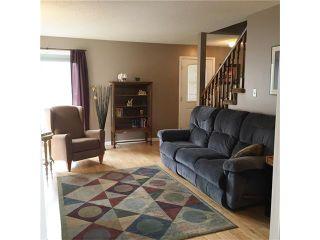 Photo 9: 351 WOODFIELD Road SW in Calgary: Woodbine House for sale : MLS®# C4050173