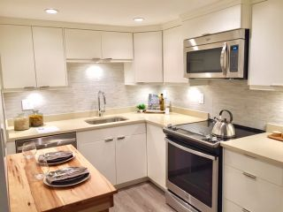 "Photo 1: 107 215 N TEMPLETON Drive in Vancouver: Hastings Condo for sale in ""PORTO VISTA"" (Vancouver East)  : MLS®# R2120278"
