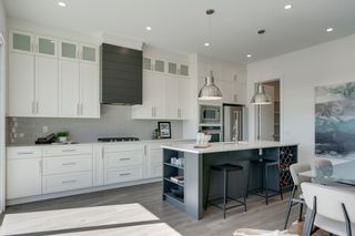 Photo 4: 158 69 Street SW in Calgary: Strathcona Park Detached for sale : MLS®# A1122439